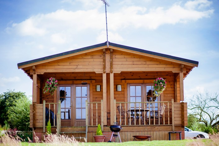 031 705x469 Promotional photography. Forest View Retreats log cabins.